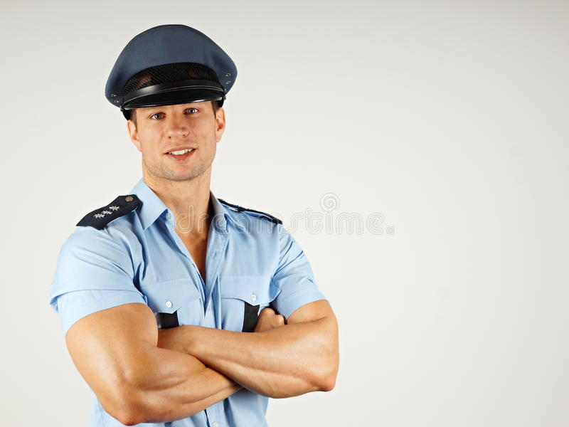 Retrato do polícia de sorriso fotografia de stock royalty free