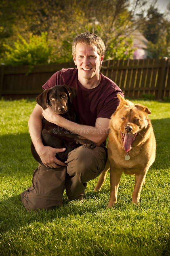 Retrato do proprietário do cão imagens de stock royalty free