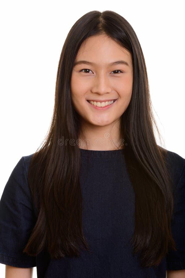 Retrato do sorriso asiático feliz novo do adolescente imagem de stock