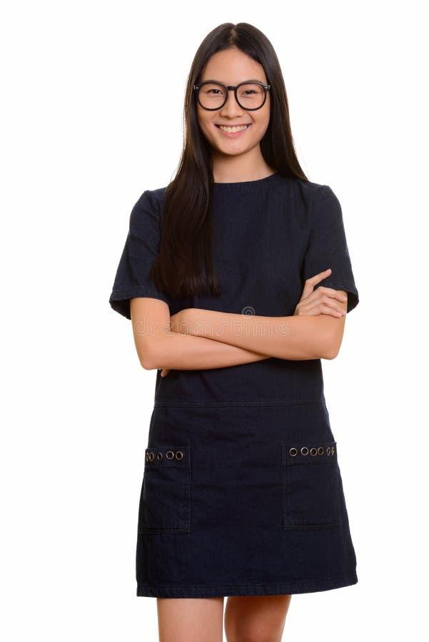 Retrato do sorriso asiático feliz novo do adolescente foto de stock