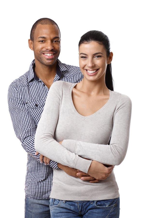Retrato do sorriso bonito dos pares da raça misturada fotos de stock