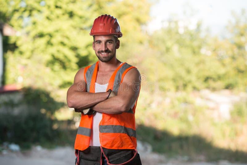Retrato do trabalhador manual profissional de sorriso imagem de stock royalty free