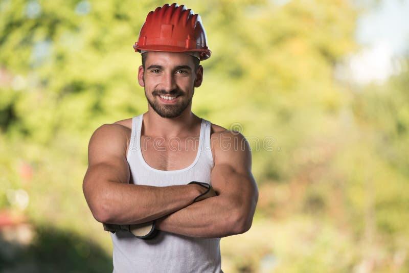 Retrato do trabalhador manual profissional de sorriso foto de stock