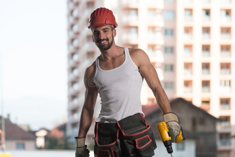 Retrato do trabalhador manual profissional de sorriso imagens de stock royalty free