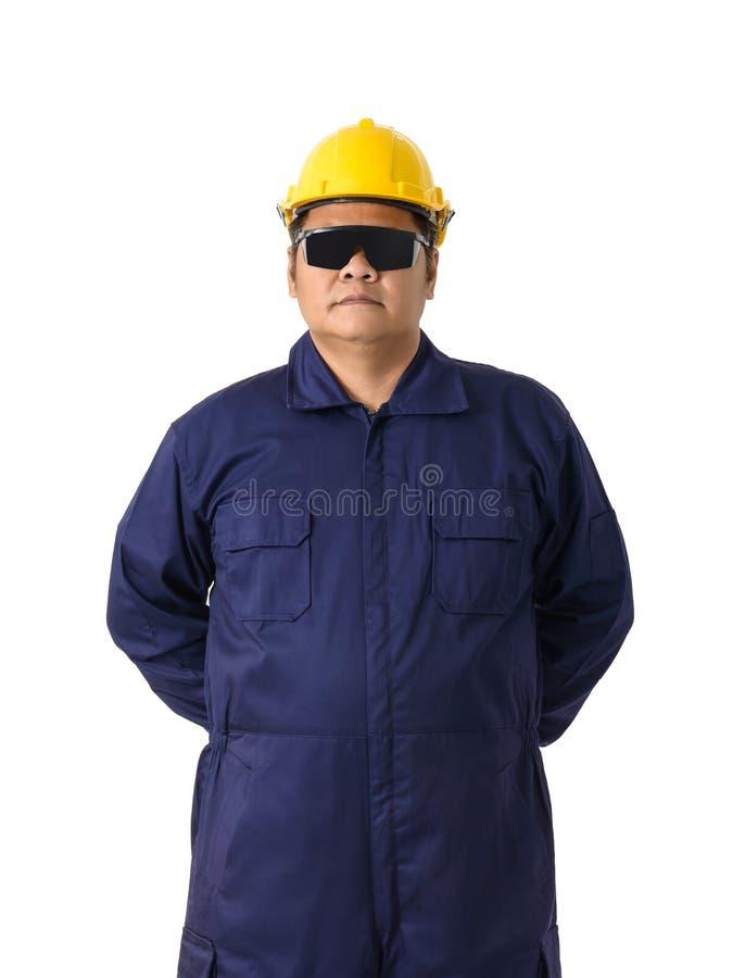Retrato do trabalhador no mecânico Jumpsuit isolado no backgr branco imagens de stock