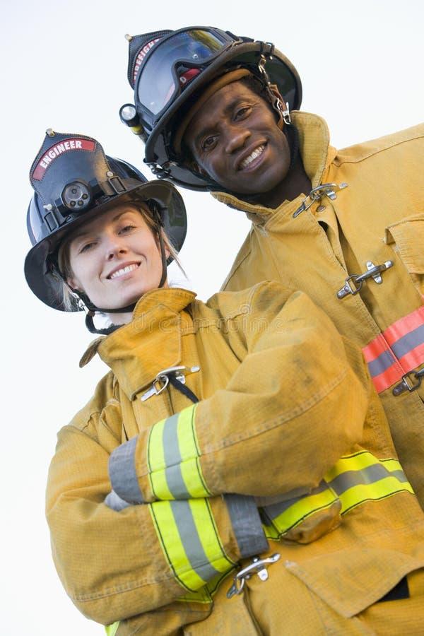 Retrato dos sapadores-bombeiros imagens de stock