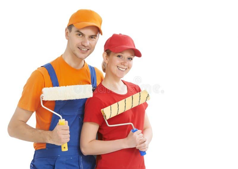 Retrato dos trabalhadores do pintor de casa isolados fotografia de stock royalty free