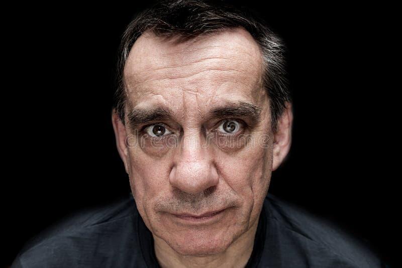 Retrato dramático del hombre de mirada infeliz triste foto de archivo libre de regalías