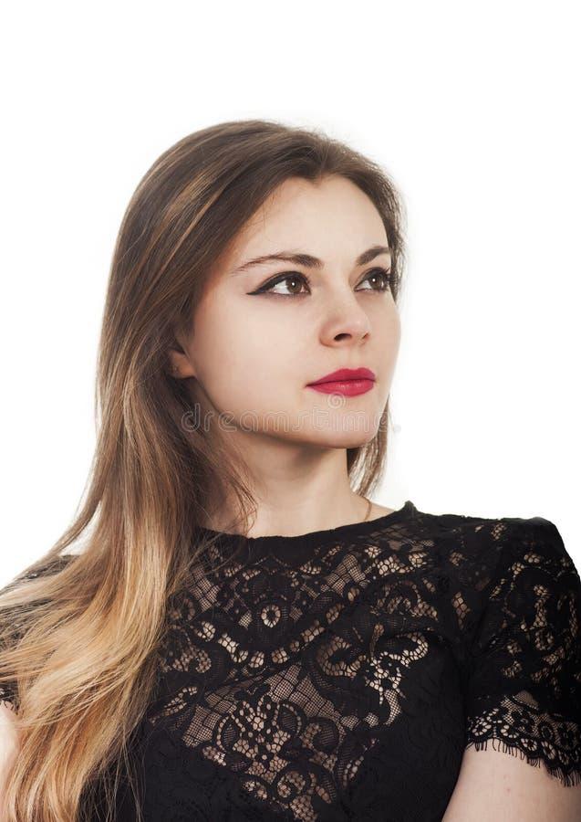 Retrato emocional de uma menina bonita em um fundo branco imagem de stock