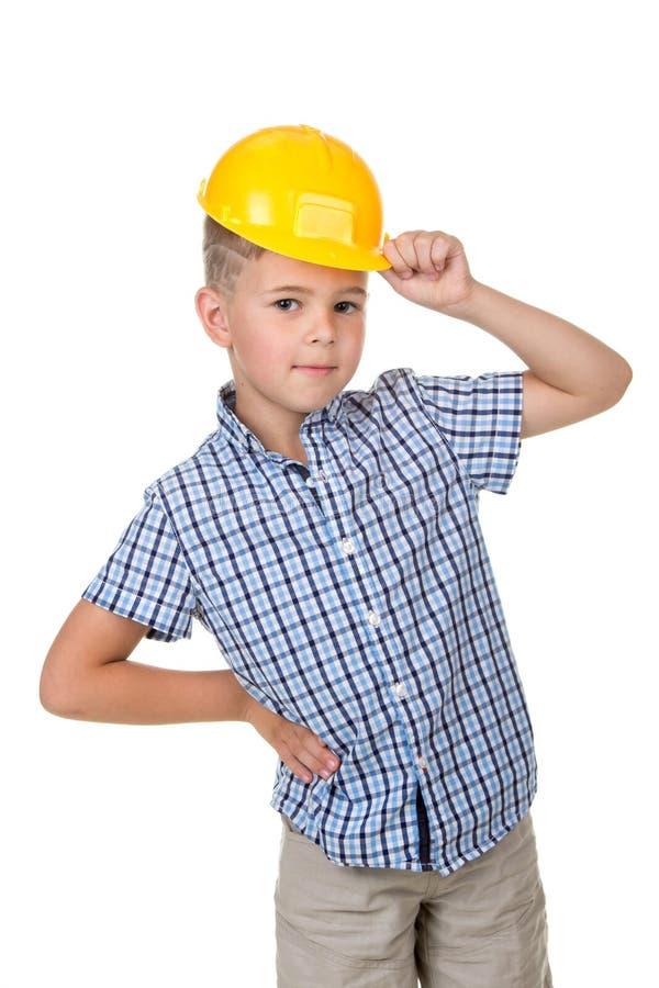 Retrato emocional do capacete de segurança amarelo vestindo da segurança do menino adolescente caucasiano considerável fotografia de stock royalty free