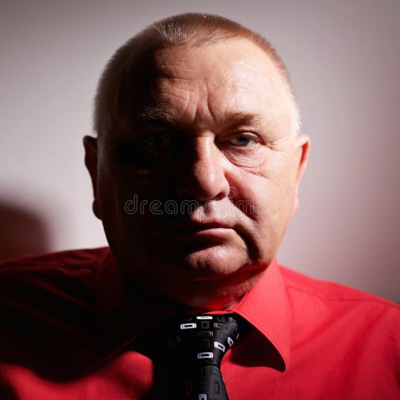 Retrato envejecido confidente del hombre fotografía de archivo