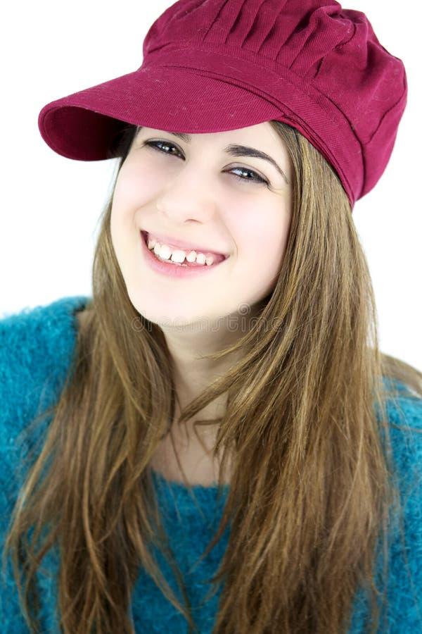 Retrato feliz colorido de la muchacha con el sombrero rosado imagen de archivo