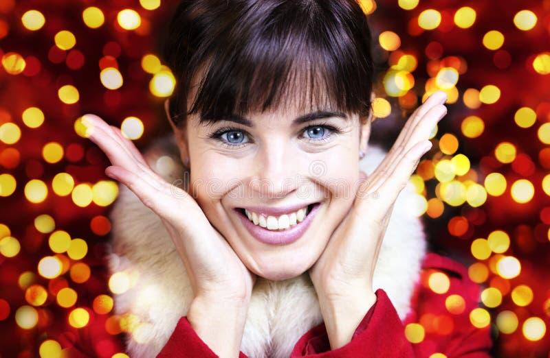 Retrato feliz de la mujer para la Navidad foto de archivo libre de regalías