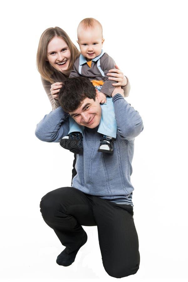 Retrato feliz novo da família com o um miúdo isolado foto de stock royalty free