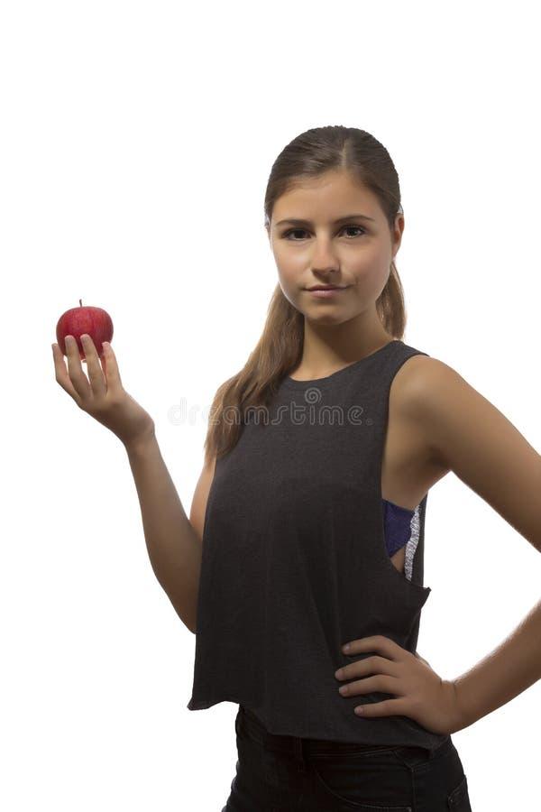 Retrato hermoso del adolescente que sostiene una manzana roja fotos de archivo