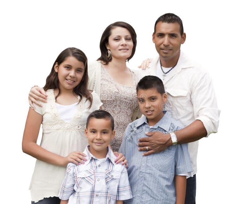 Retrato hispánico atractivo feliz de la familia en blanco foto de archivo