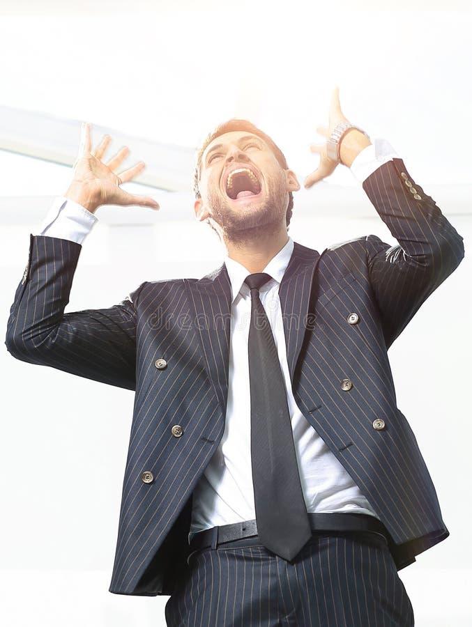 Retrato, homem de negócios triunfante, isolado no fundo branco fotografia de stock