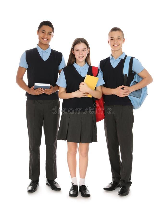 Retrato integral de adolescentes en uniforme escolar foto de archivo libre de regalías