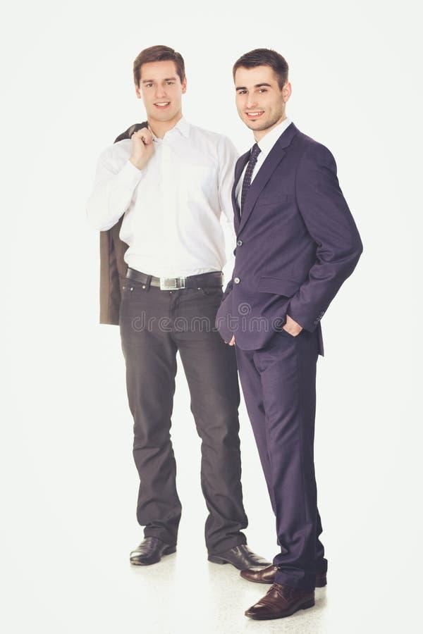 Retrato integral de dos hombres de negocios que se unen fotografía de archivo libre de regalías