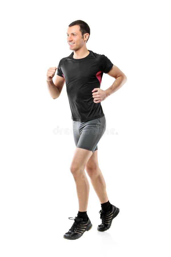 Retrato integral de un funcionamiento masculino del atleta foto de archivo libre de regalías