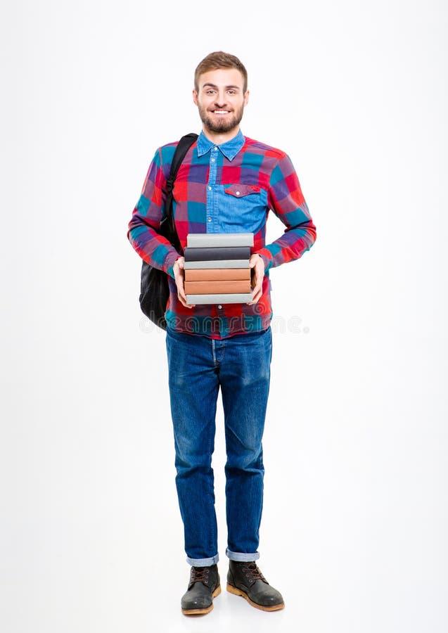 Retrato integral de un hombre feliz que sostiene los libros fotografía de archivo