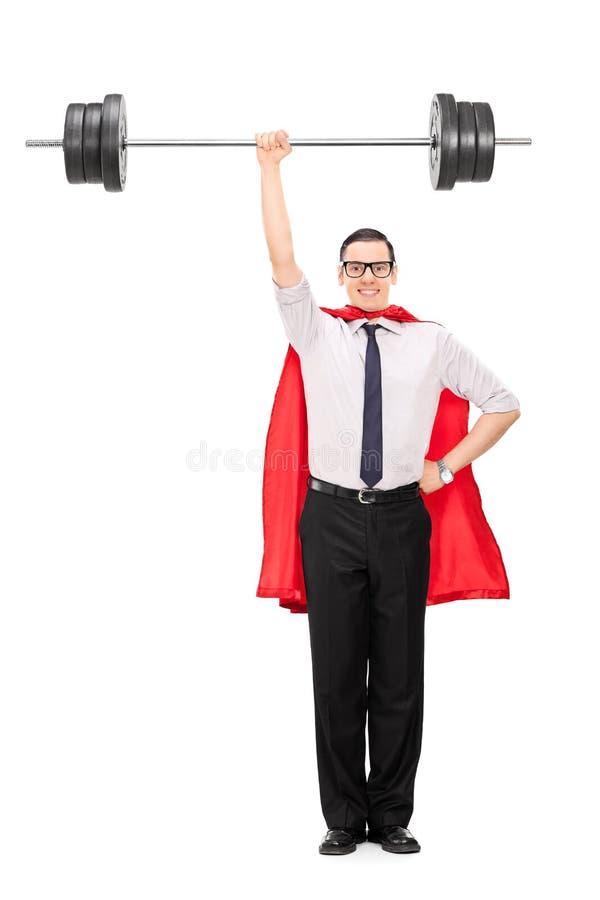 Retrato integral de un super héroe que detiene a un peso pesado imagen de archivo
