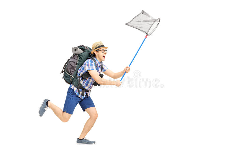 Retrato integral de un turista masculino que corre con el ne de la mariposa fotografía de archivo