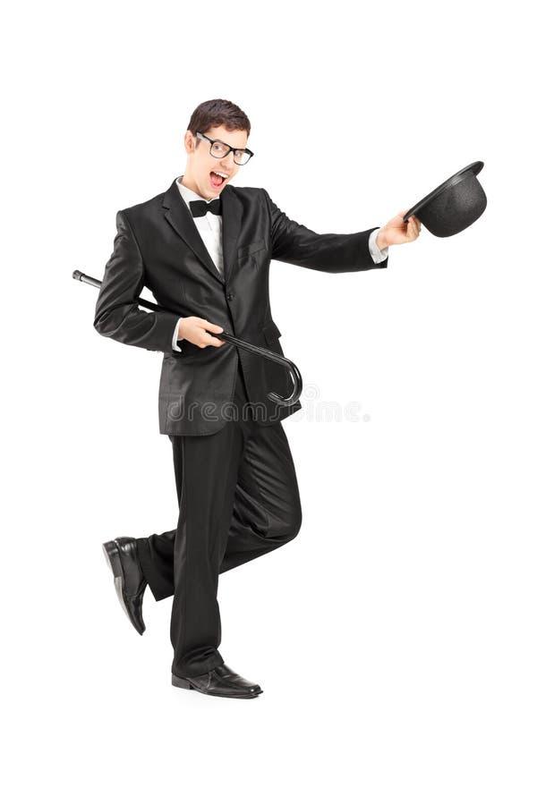 Retrato integral del hombre joven alegre en un traje de la pajarita imagen de archivo