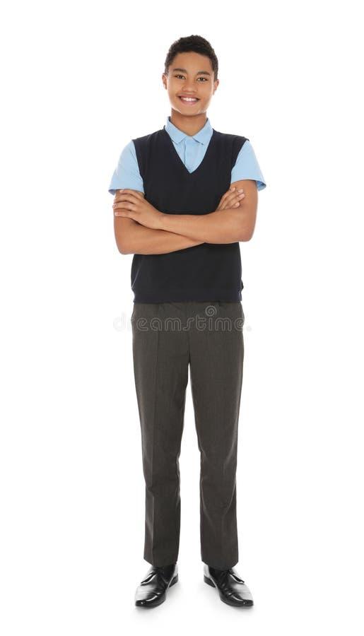 Retrato integral del muchacho afroamericano en uniforme escolar foto de archivo libre de regalías