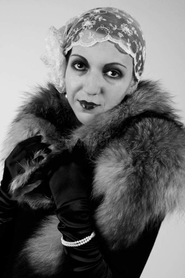 Retrato labrado retro de una mujer joven imagen de archivo libre de regalías