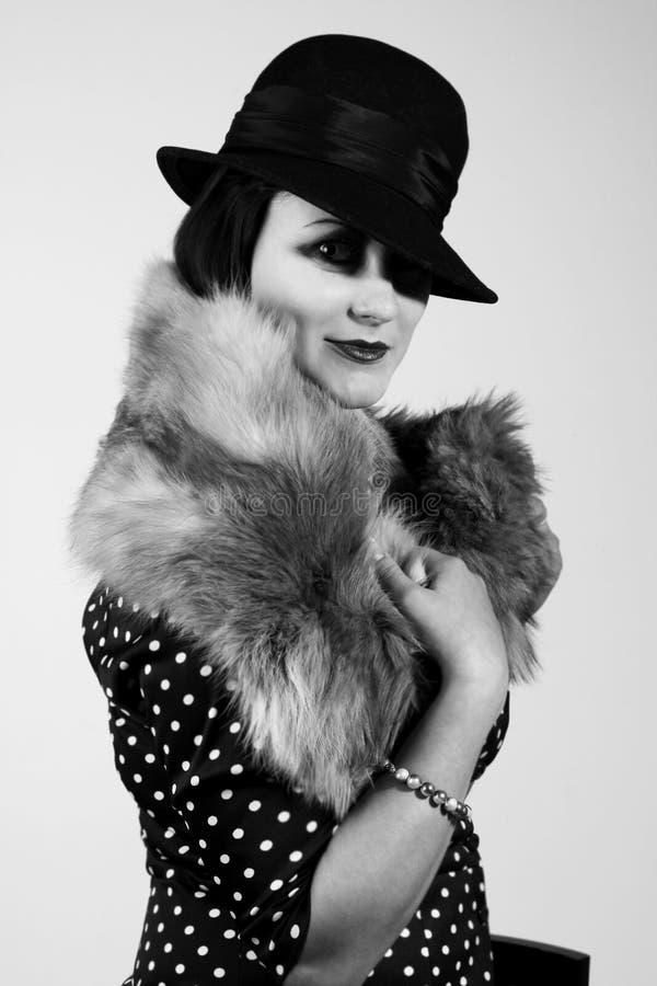 Retrato labrado retro de una mujer joven imagen de archivo