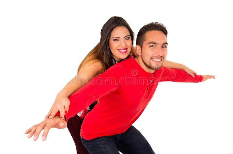 Retrato lleno de los pares felices aislados en el fondo blanco Hombre atractivo y mujer que son juguetones foto de archivo libre de regalías