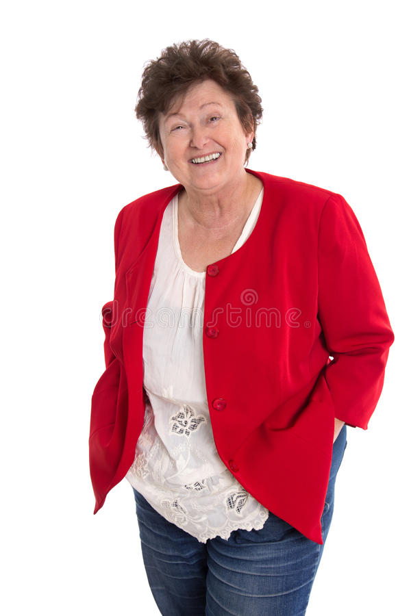 Retrato: Más vieja mujer feliz jubilada aislada en el blanco que lleva a imagen de archivo libre de regalías