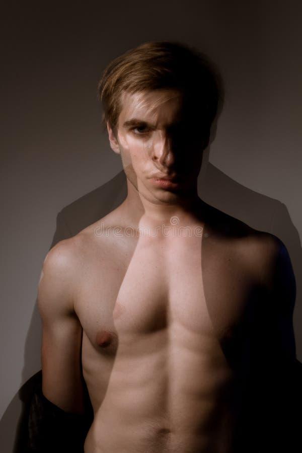Retrato masculino de um dançarino com uma exposição dobro no estúdio imagem de stock royalty free