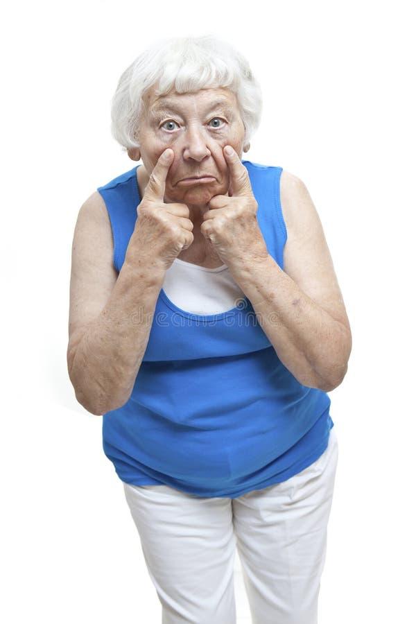 Retrato mayor de la mujer de la incredulidad fotografía de archivo
