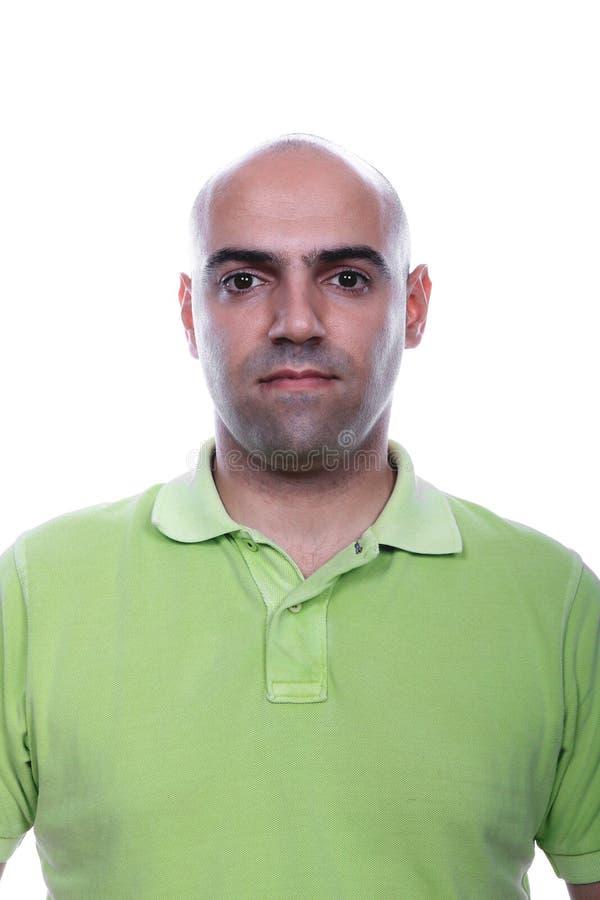 Retrato ocasional do homem com a camisa de polo verde foto de stock royalty free
