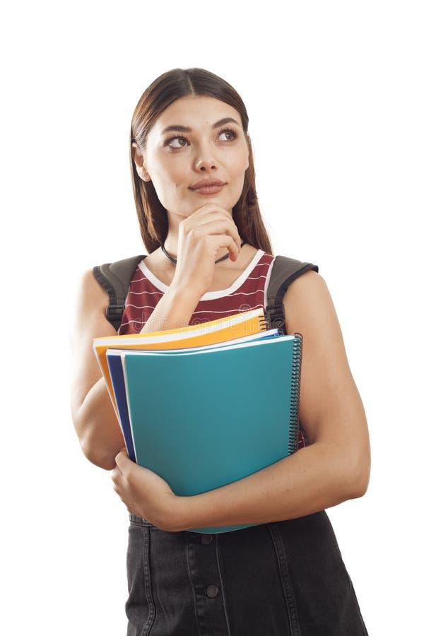 Retrato pensativo del estudiante en blanco imagen de archivo
