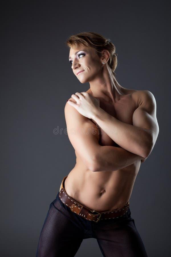 Retrato pesado de la mujer del constructor de carrocería imagen de archivo libre de regalías