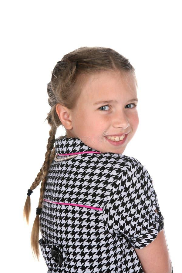 Retrato principal e dos ombros da menina bonito nas tranças imagem de stock royalty free