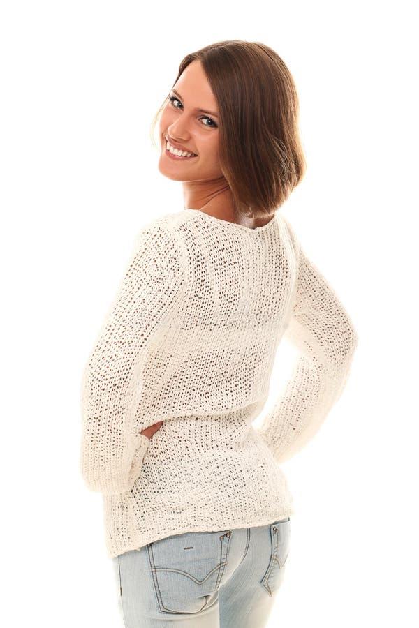 Retrato sonriente de la mujer hermosa sobre un blanco imagenes de archivo