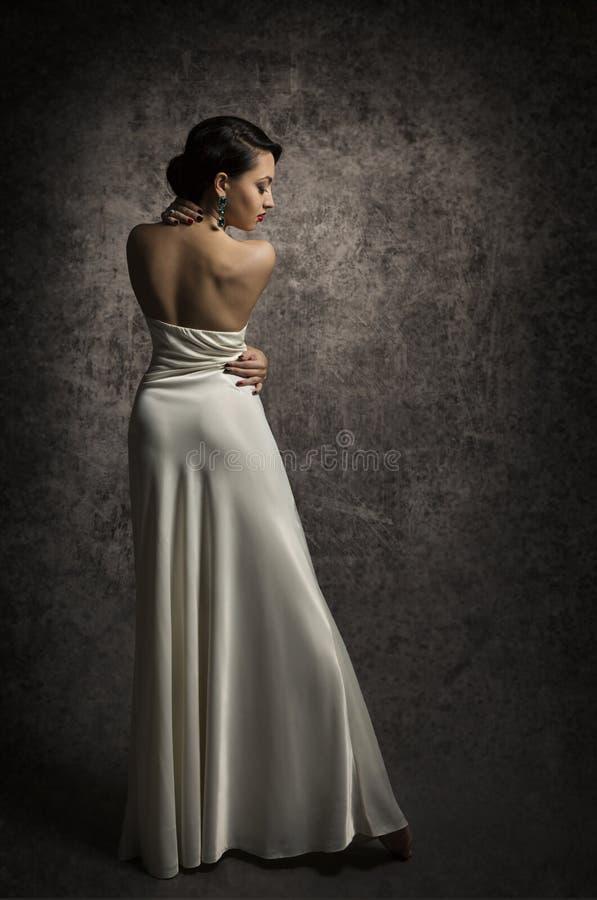 Retrato traseiro da beleza da mulher, senhora elegante Posing no vestido 'sexy', S foto de stock royalty free