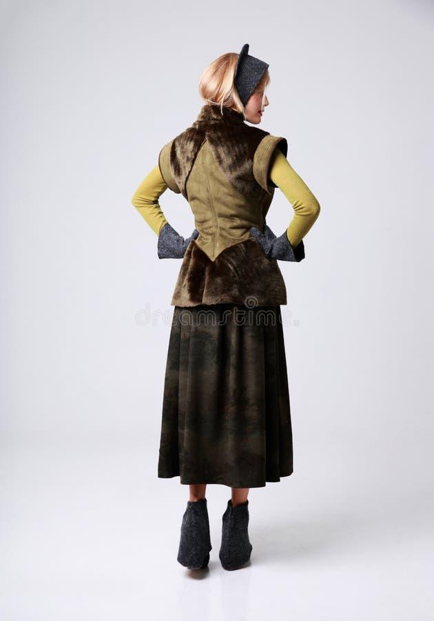 Retrato traseiro da vista de uma mulher na moda foto de stock royalty free