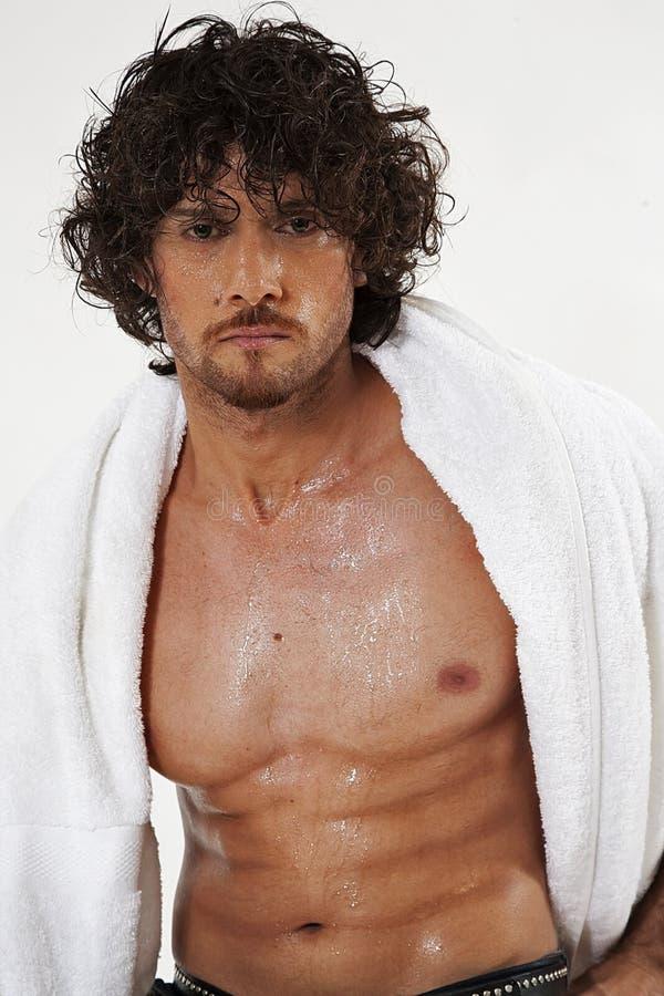 Retratos semi desnudos del hombre muscular hermoso fotos de archivo libres de regalías