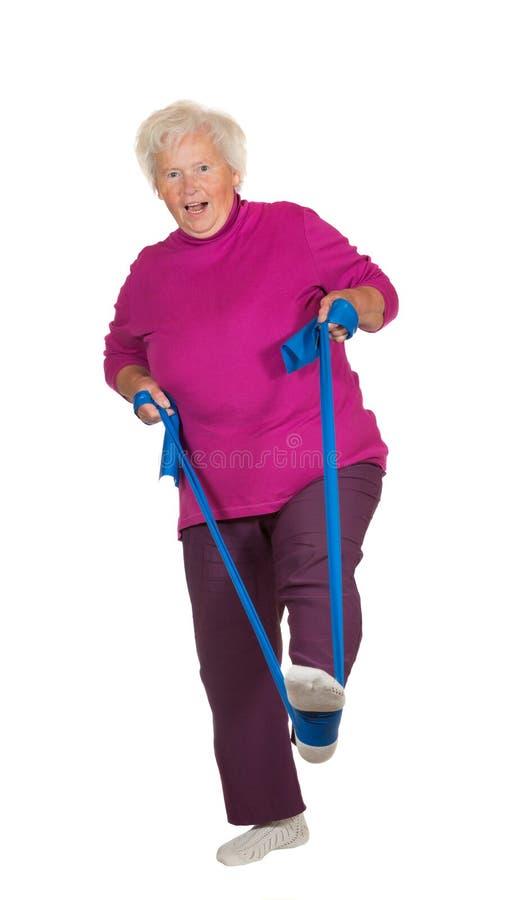 Retried senior woman exercising stock images