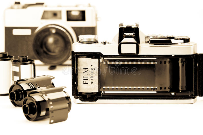 Retro 35mm camera with film opened back side. stock image