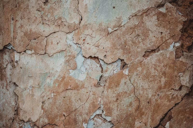 Retro abstract closeup of brown ruined wall. Brown cement concrete stucco. Brown stucco wall background grungy texture. Cracks in stock image