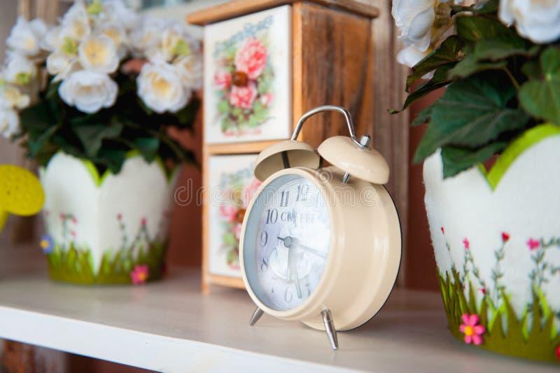 Retro alarm clock with coffee inscription inside royalty free stock photo