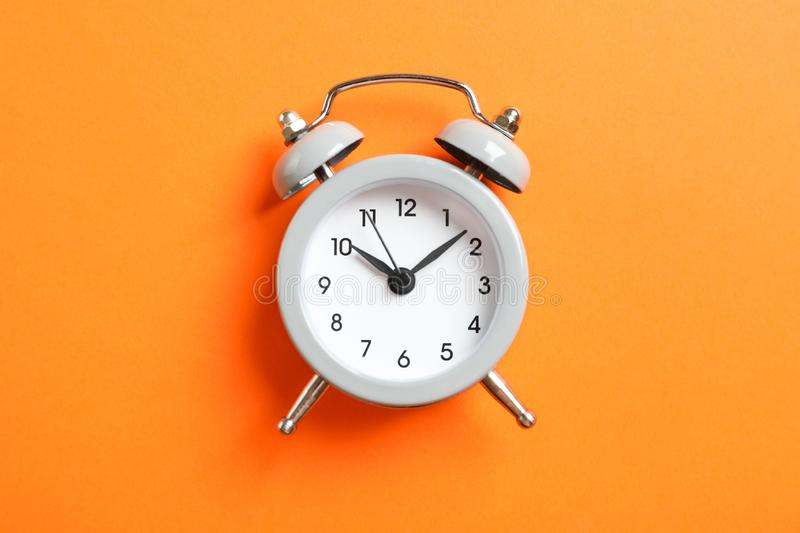 Retro alarm clock on color background. Space for text stock photography