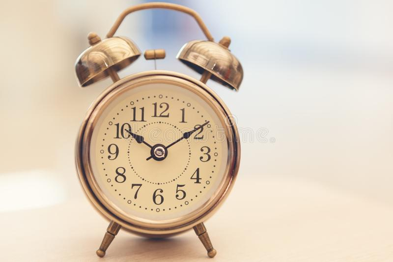 Retro alarm clock on table royalty free stock images