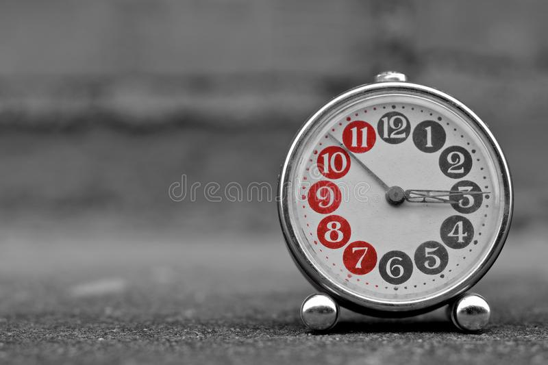 Retro alarm clock with vintage efect. Retro alarm clock with retro vintage efect stock photos